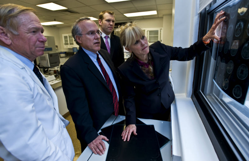 Doctors at the BU CTE Center examine brain injury pictures